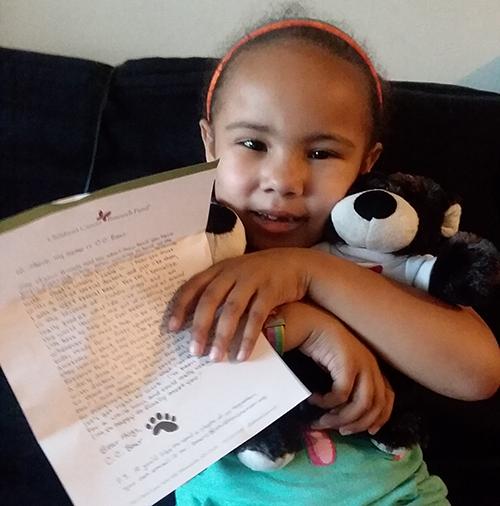 Child with C.C. Bear